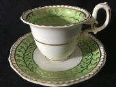 H & R Daniel green and gilt coffee cup & saucer